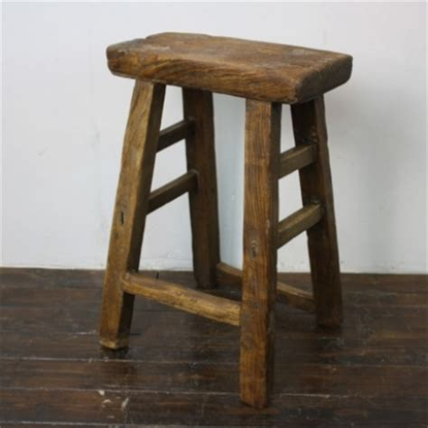 rustic varnished wooden stool v58 lovely and company