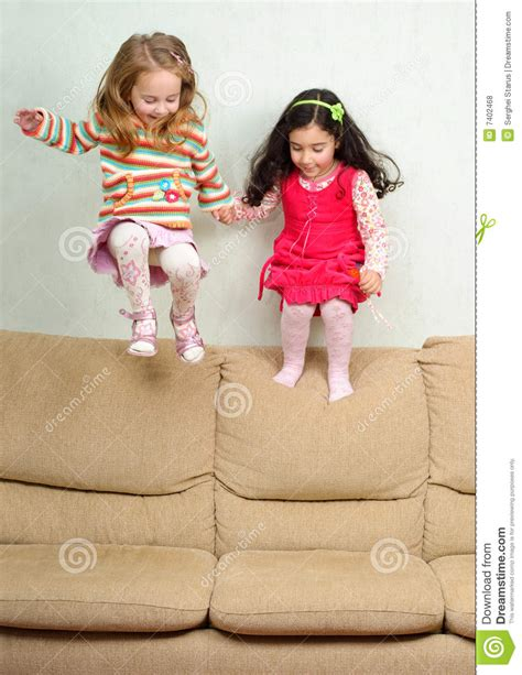 little girls sofa two little girls jumping on sofa royalty free stock photos