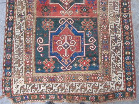 Bad Rug by Kazak Rug With 3 Medallions And Bad Repairs