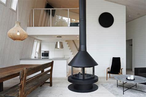 fireplace in middle of room chalet lagunen designed by mats edlund henrietta palmer
