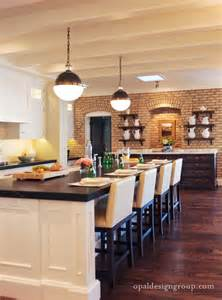 warm kitchen with an exposed brick wall home