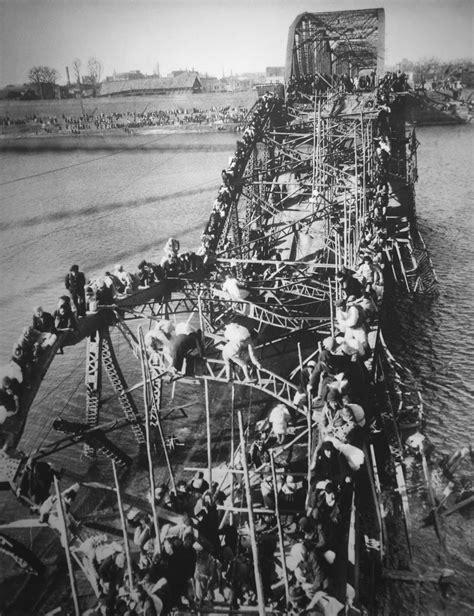 Flight of Refugees Across Wrecked Bridge in Korea | 1951
