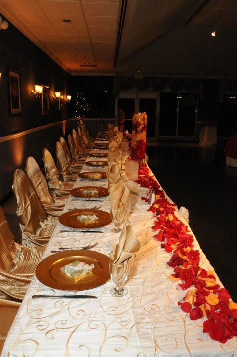 our table our colors for the wedding were burnt orange and gold we did linens