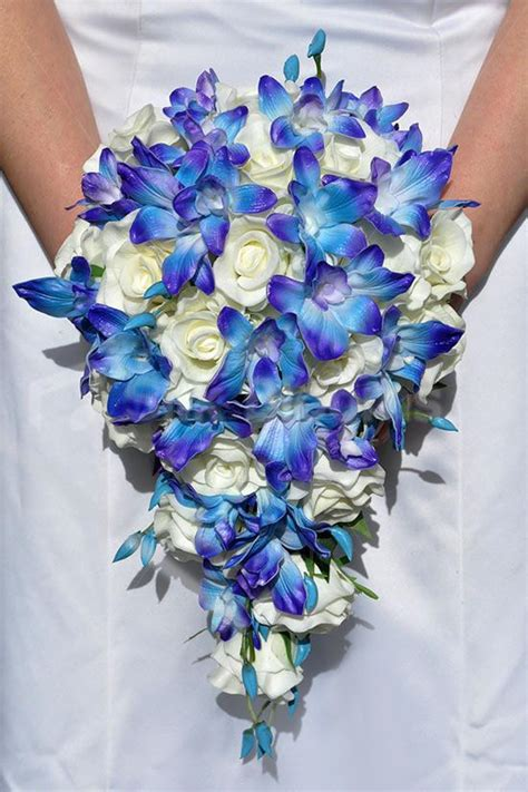 stunning galaxy blue orchid  ivory rose cascading