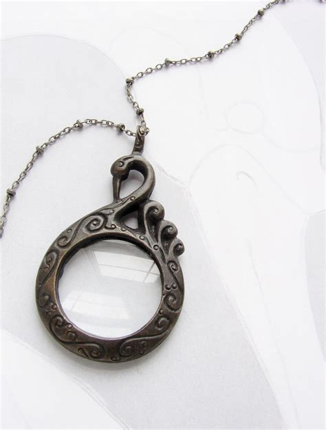 statement necklace black swan magnifying glass necklace