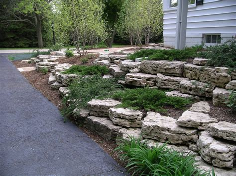 Modern Budget Deck retaining walls and outcroppings treetops landscape