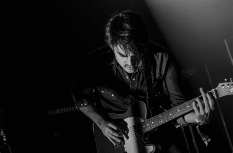 who is the man with guitar in the direct tv commercial grayscale photo of man playing electric guitar 183 free