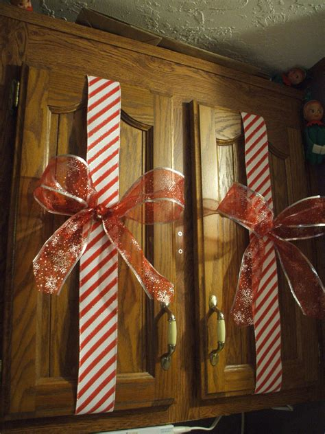 christmas bows on kitchen cabinets gray cardigan holiday decorated cabinets