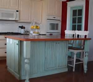 White painted cabinets w diff color paint on island