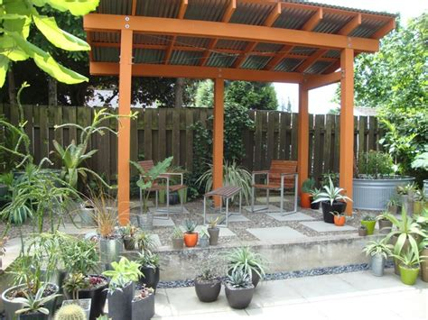 Backyard Landscape Structures Great Backyard Shade Structure I Like The Pebble Choice