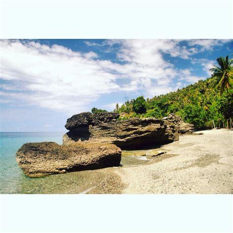 pantai enu tawarkan lokasi snorkeling keindahan sunset