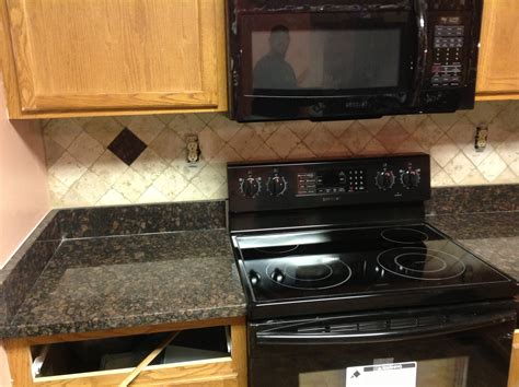 donna s tan brown granite kitchen countertop w travertine backsplash granix
