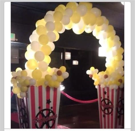 themes in the black balloon film balloon arch popcorn awesome for movie themed party
