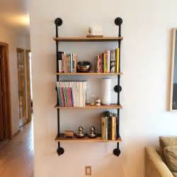 wall mounted shelving units wall mounted pipe shelving unit by cushdesignstudio on etsy