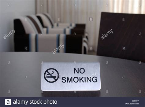 no smoking sign hotel no smoking sign on table in a hotel room stock photo