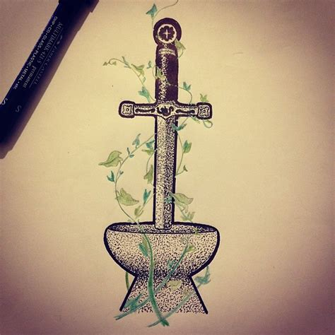 sword in the stone tattoo designs whoso pulleth out this sword of this and anvil is