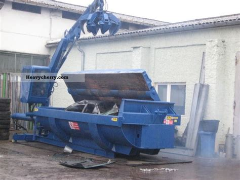 car  mobile trash compactor  crane  roll