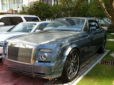 blue rolls royce drophead coupe with custom rims