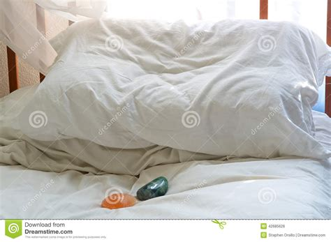 two pillows on bed stock photo image of domestic room pillow on bed with healing stones stock photo image of