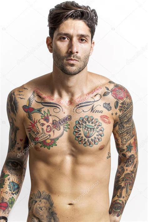 sexy tattooed handsome and tattooed looking at stock