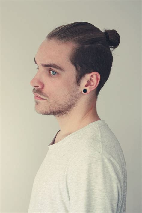 ponytail on top short on sides men trendy chic hairstyling guide for upcoming christmas