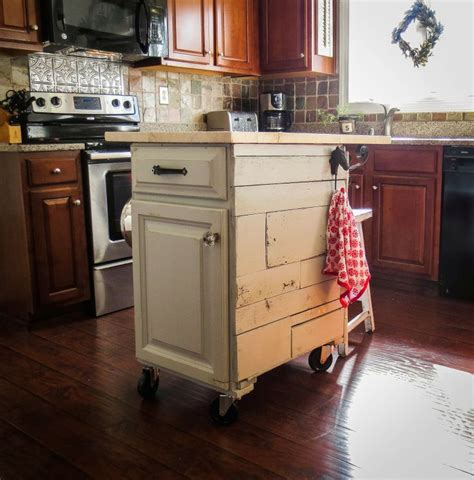 Mobile Kitchen Cabinets Re Purposed Cabinet Turned Into A Mobile Kitchen Cart The Top Is Spruce Wood That Looks Like