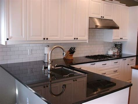 backsplash for white cabinets and black granite i like the white subway tile backsplash with the dark