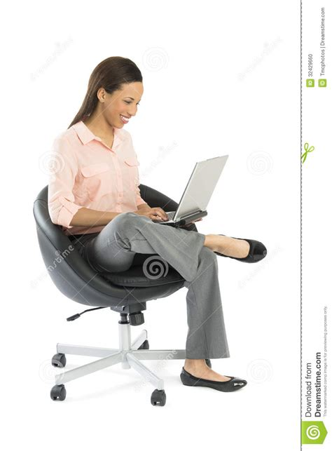 Sit On It by Businesswoman Using Laptop While Sitting On Office Chair