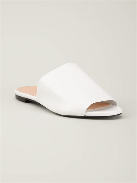white sandals flat robert clergerie flat slide sandals in white lyst