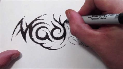 tattoo designs with names hidden in them custom tribal name design