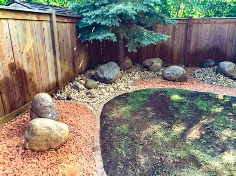 Garden Shale Rock Rock Garden With Shale Riverwash Fieldstone Boulders Bordered With I Con Edger The Lawn