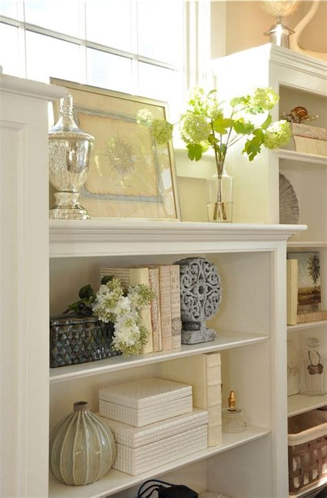 17 best ideas about arranging bookshelves on