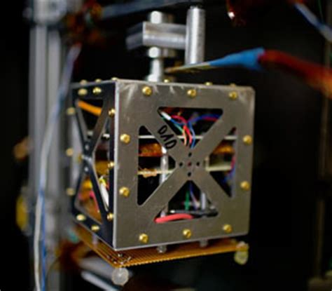 Inside A Vacuum Mini Ion Thrusters Could Propel Small Satellites In Space