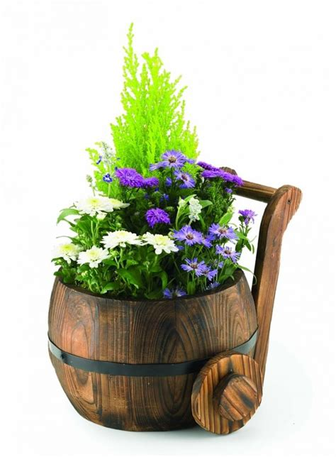 Decorative Wooden Planters by Decorative Burnt Wood Fir Churn Planter
