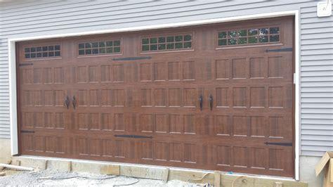 Oak Summit Garage Door Carriage Style Garage Door Amarr S Oak Summit With Stockton Windows In Walnut Www