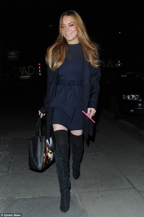 Style Stealer Lindsay Lohans Blue Dress 2 by Lindsay Lohan Puts On A Leggy Display In The Knee