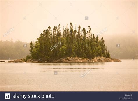 canoes in a fog lake superior lake superior park stock photos lake superior park stock