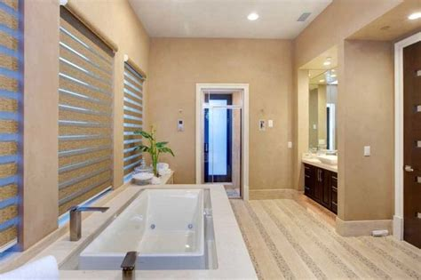 beige paint color in this zen and spa like master bathroom which features a modern bathtub