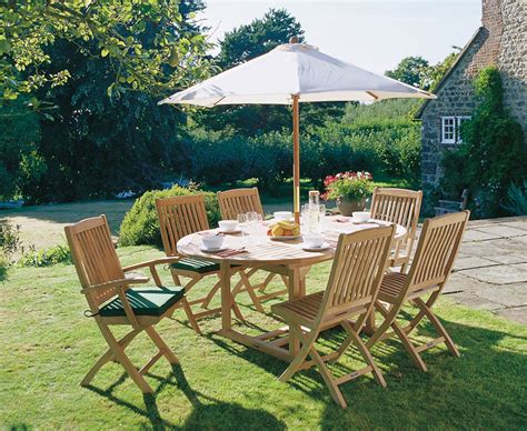 Brompton 6 seater extending garden table and folding chairs lindsey teak
