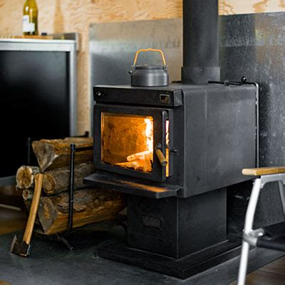 Wood Stove In Cabin by The Signal Shed