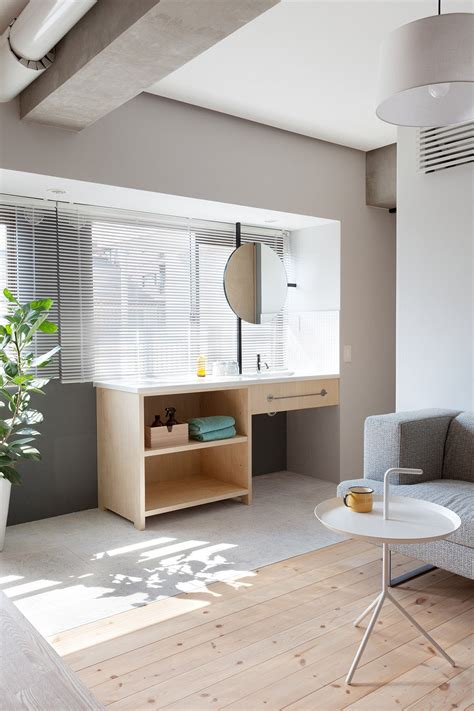l shaped apartment l shaped wood partition unifies all areas in small