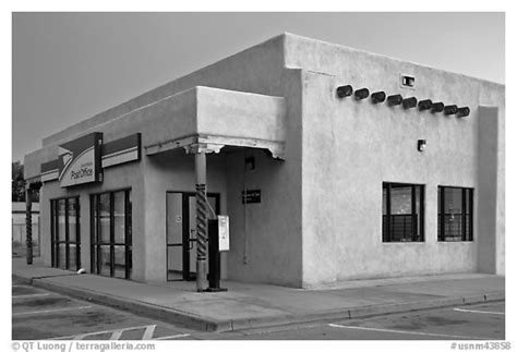 black and white picture photo post office in adobe style