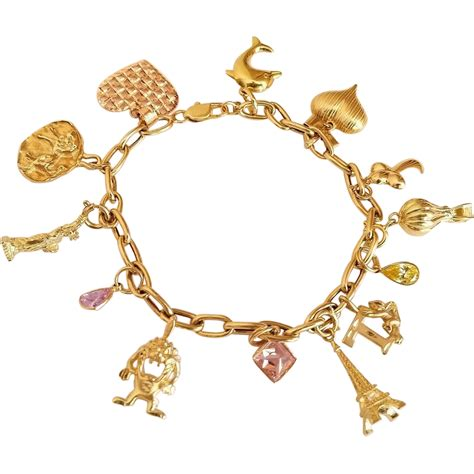 beautiful 14k gold charm bracelet with 10k and 14k gold
