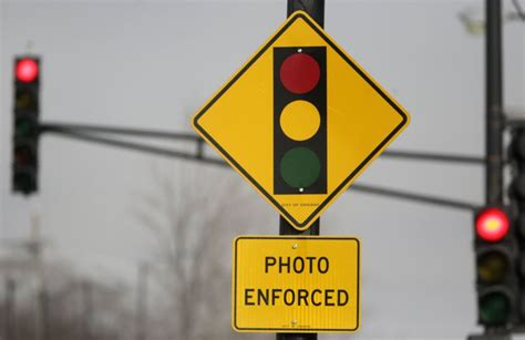 city of chicago red light camera lawsuit red light traffic camera firm will pay the city 20