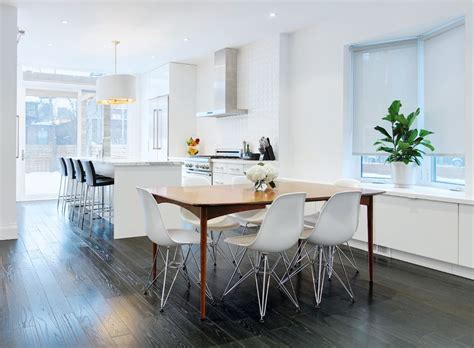 black hardwood flooring Dining Room Contemporary with bay