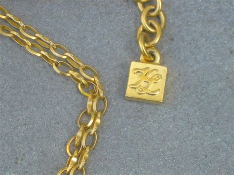 Karl Lagerfeld Gold karl lagerfeld vintage gold plated cupid necklace and earring set at 1stdibs