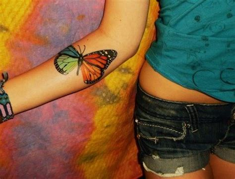 tattoos on the inside of your arm rainbow butterfly on the inside of your arm