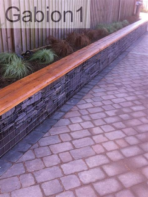 small gabion retaining wall and timber capping http www gabion1 co uk driveway pinterest