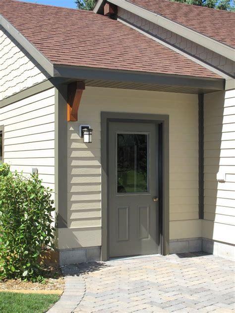 Steel Garage Entry Doors Exterior Doors Steel Garage Door Painted Grey With Light Yellow Siding Bayer Built Woodworks