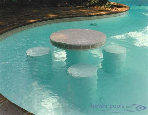 pool tables and bar stools in pool amenities dipping into something special haven
